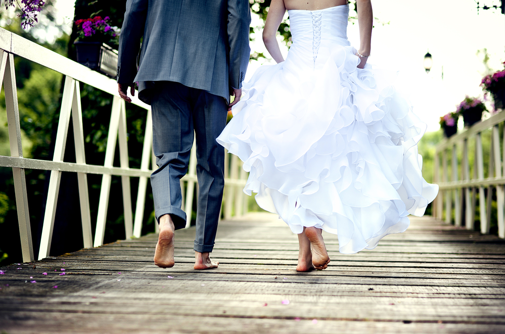 Barefoot wedding couple